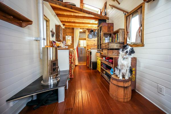 Jenna & Guillaume's Kimberly wood stove in their traveling tiny home - Off-Grid Heating: Propane VS. Wood Burning - Tumbleweed Houses