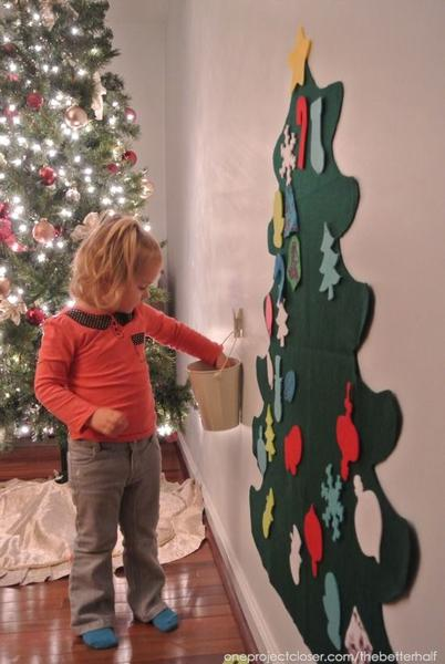 diy wall mounted tree create wall art in the shape of a tree use branches ornaments or a single stand of lights the kids will love this diy project