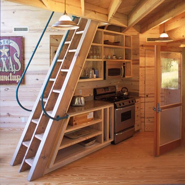 Tiny House Stairs cabinets stairs with flip up steps and very narrow stairs each step goes up Photo Credit Tiny House Living